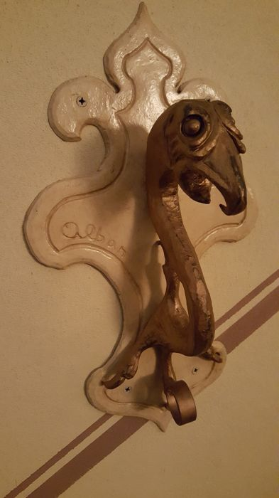 """Four wrought iron """"dragon heads"""" with grommets - signed by Albano Giovanni, Italy, 1920s"""