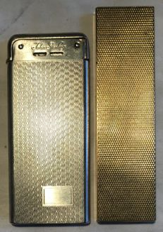 A pair of ultra-thin lighters - 1970s - in steel and in gold plated steel