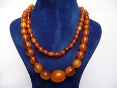 Antique necklace of 100% natural orange egg yolk Amber, from mid and late 19th century, 46.1 grams