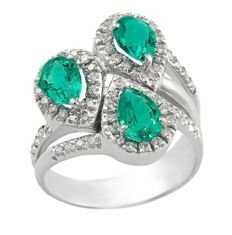 18 kt white gold ring with 2.24 ct emeralds and 0.55 ct natural diamonds