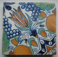 Antique multicoloured Rosette tile with pomegranate and grapes, Ornament type