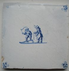 Antique tile with child's play (rare)