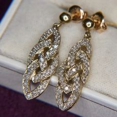 Pair of long gold earrings set with 22 octagon cut natural diamonds, approx. 0.20 ct, length 2.5 cm.