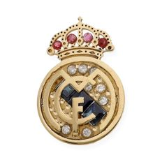 750/1000 (18 kt) yellow gold Real Madrid crest with 8 inlaid diamonds weighing 0.20 ct in total, 4 rubies and 3 sapphires