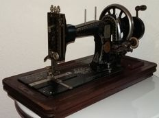 Decorative Gritzner manual sewing machine with mother of pearl and wooden cover, Germany, approx. 1915