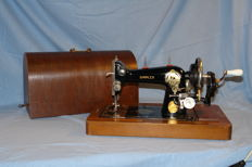 Simplex hand sewing machine including wooden hood and key, Dutch, ca. 1930