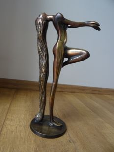 Naked woman in a graceful pose