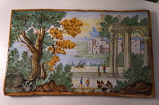 Hand painted majolica tile with landscape and ruins in Anastasio Grue style