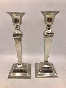 Set heavily silver plated Art Deco candle stands.