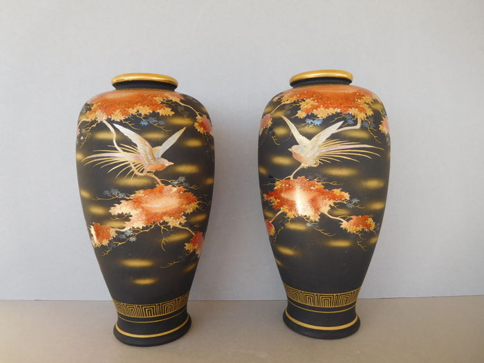 A Pair Of Large Satsuma Vases With A Black Background Decoration