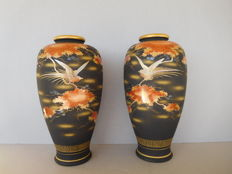 A pair of large Satsuma vases with a black background decoration - marked 'Satsuma' - Japan Showa period  - second half 20th ce.