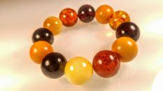 Baltic Amber modified round beads mix colors bracelet, hole ca. 56 mm diameter