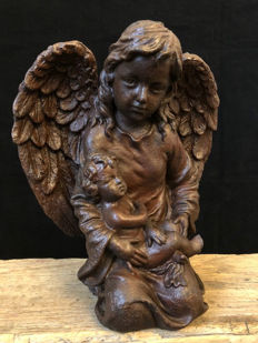 Cast iron angel with child