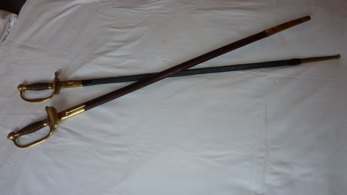 2 presumably Dutch swords