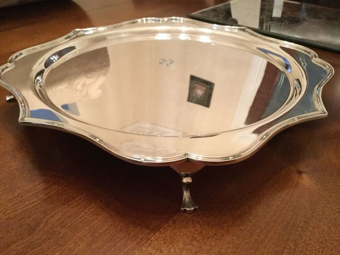 Antique and large silver plated tray with scalloped edge and feet
