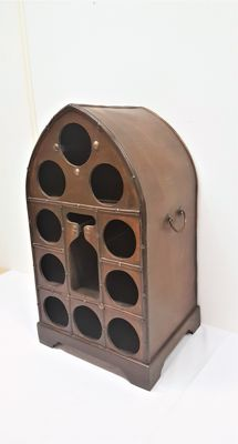 Vintage wooden wine cabinet with copper fittings