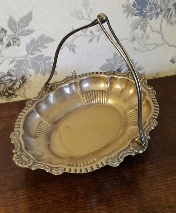 Nice silver plated basket with swivel handle and clawed feet