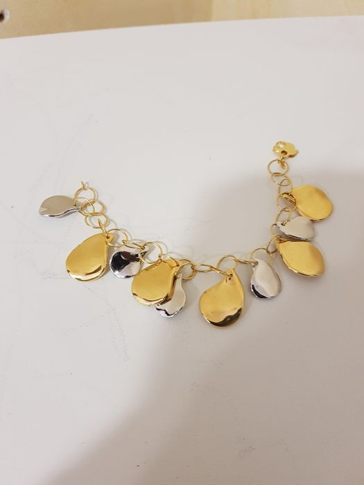 Bracelet in 18 kt gold with two-tone charms