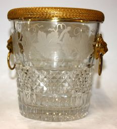 Diamond-cut crystal ice bucket with vine decoration, carved gilt bronze rim and lion heads