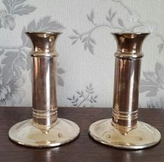Pair of silver plated candlesticks, simple design
