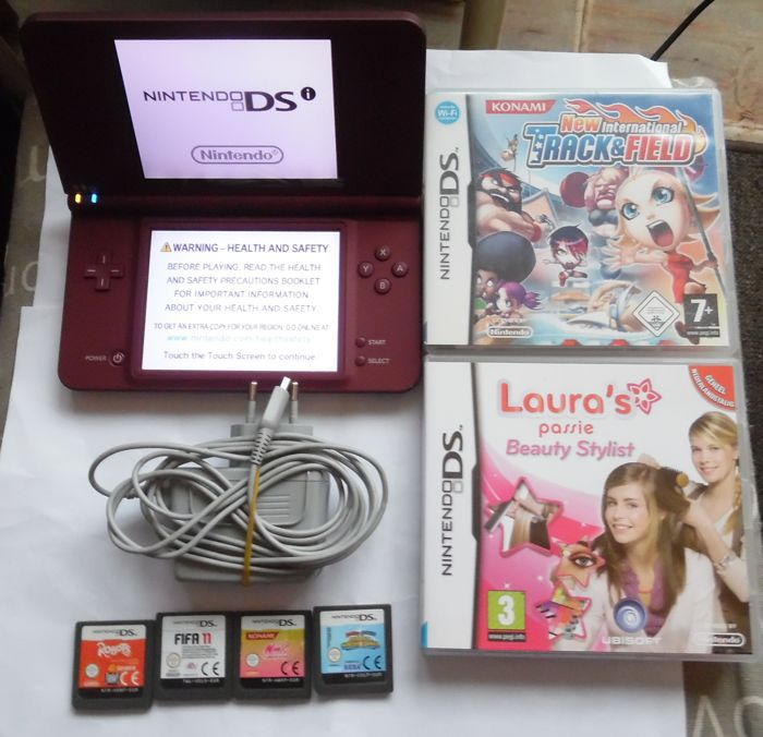 DSI xl  color bordoux + charger + 6 games like mario & sonic + robot + winx+ track field