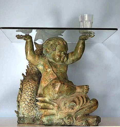 Italian coffee table with transparent glass in the form of a putto on a classical mythological dolphin - 20th century - Italy - bronze