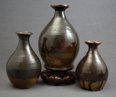 3 Shiwan wine bottles with dark brown glaze - China - end of the 20th century