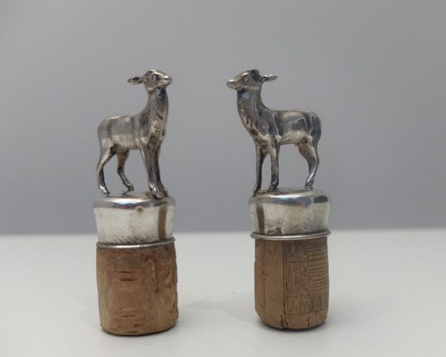A pair of silver decorative corks with deer, Belgium, 20th century