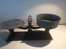 Antique scale with an assortment of weights