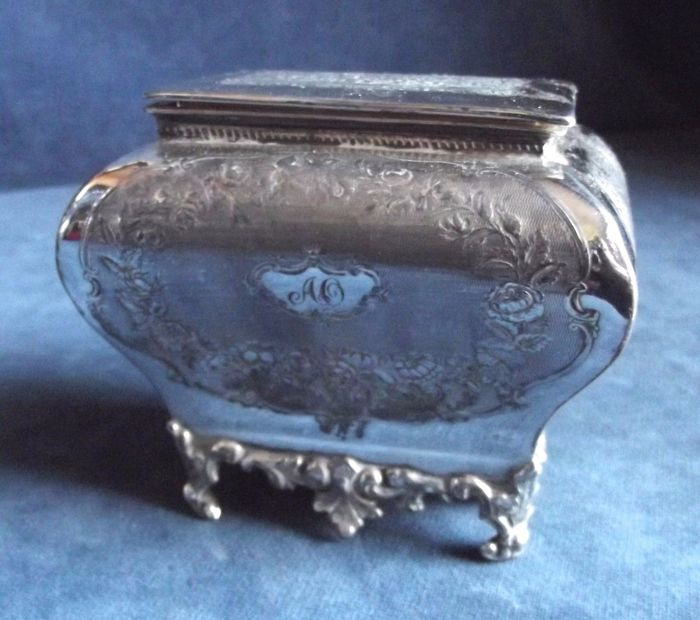 Silver Plated Tea box shaped like a trunk and richly decorated, ca. 1910