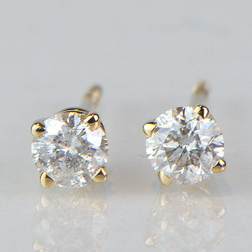 Gold stud earrings with solitaire diamonds totalling 0.33 ct – approx. 3.5 mm