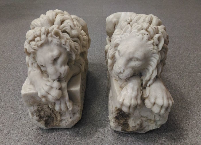 "Two lions in marble dust, replica of those made by Canova for the monument to Pope Clement XIII, realised between 1783 and 1792. They are also known as the ""sleeping lion"" and the ""crouching lion"""