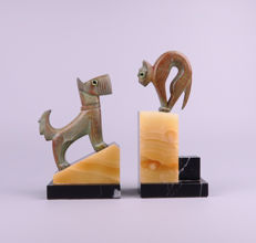 A pair of Art Deco patinated metal bookends - ' Dog and cat'