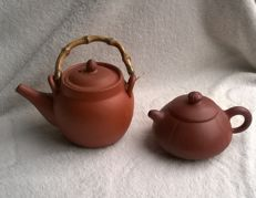 2 original Chinese Yixing teapots which are marked in the lid, bottom and belly.