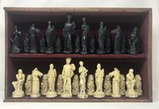 Chess frieze of large sculptures with display glass cabinet.