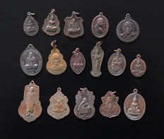 Lot of 16 monastery amulets - talismans - Thailand - Late 20th century.