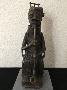 BENIN image most likely made out of bronze.
