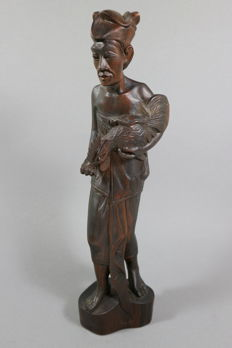 Wood carving, man with his fighting cock - Bali / Indonesia - 2nd half 20th century