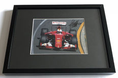 Framed photo, authentic and personally hand signed by Sebastian Vettel