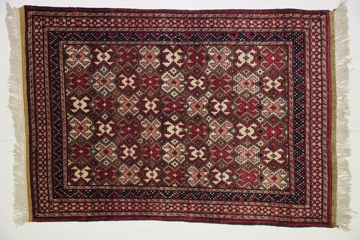 Afghanistan carpet measuring 165 x 115 cm.