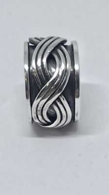 Very wide silver men's ring with rotating central part