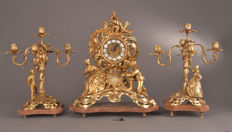 Magnificent three-piece large French bronze clock with candlesticks - fire-gilded - with a romantic depiction - France - 20th century