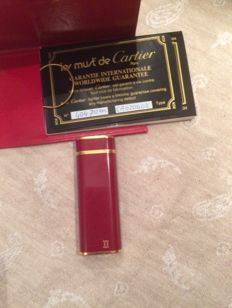Cartier lighter, gold with cartier red