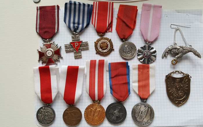 10 Polish decorations + military pilot badge + brass patriotic gorget