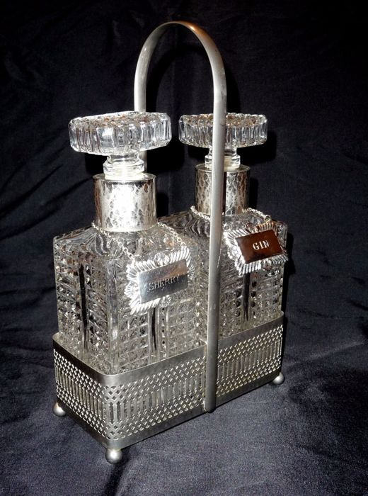An antique silver decanter set, with silver plated labels (Sherry and Gin) - England, c. 1900