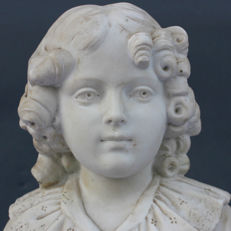 Bust made of bisque with a marble base - depicting a child wearing the emblem of the French imperial family