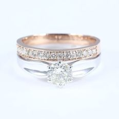 Set of 2 rings with 0.77 ct. Center Solitaire diamond and side diamonds of 0.24 ct. -Total 1.01 ct  - Ring size: 53  (FR) /17 mm