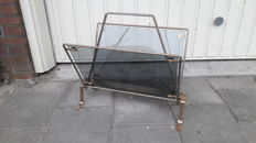 Manufacturer unknown - metal with smoked glass foldable magazine rack