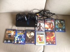 Playstation 2 (SCPH-39004), with 2 controllers, all cables and 13 original games like Kingdom Hearts
