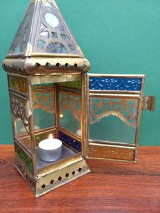 Very old lantern with stained glass